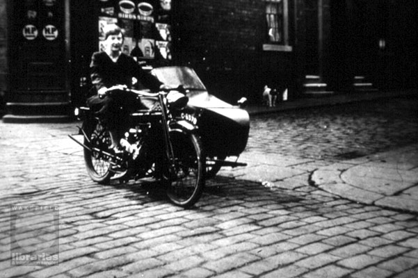 A motorbike with side car, 1930s